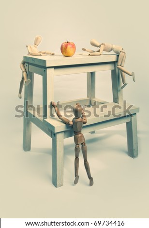 Three jointed dolls try to get to the apple first