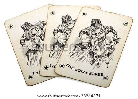 Three joker playing cards on a white background - stock photo