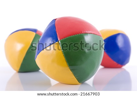Three juggling balls isolated on white background