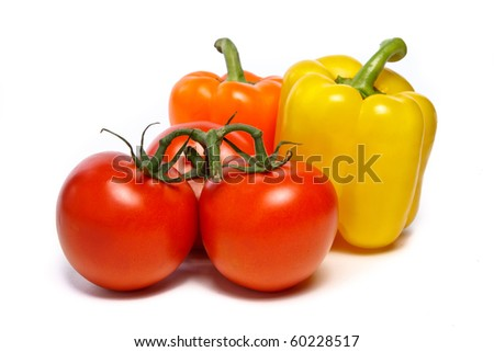 Three juicy tomatoes and two sweet peppers - stock photo