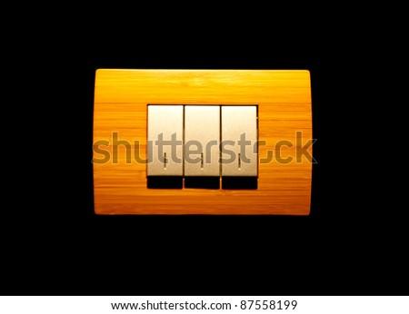 Three-key light switch on black - stock photo