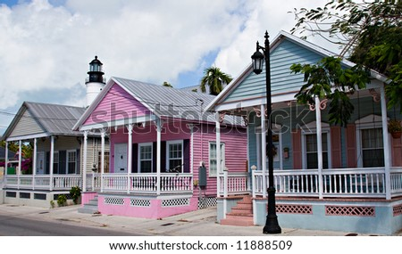 Three Key West Cottages and the Lighthouse - stock photo