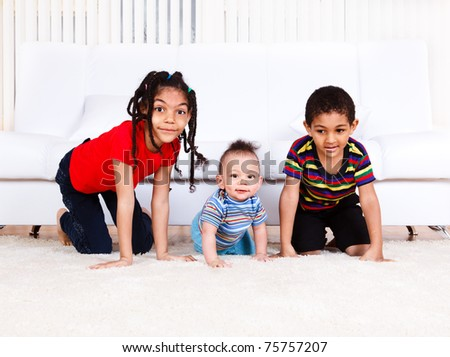 Three kids crawling in the room - stock photo