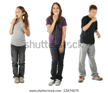 Three kids eating ice cream, isolated on white - stock photo