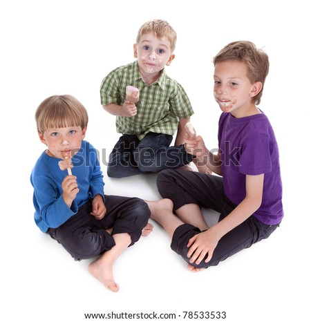 three kids eating ice lolly on white background - stock photo