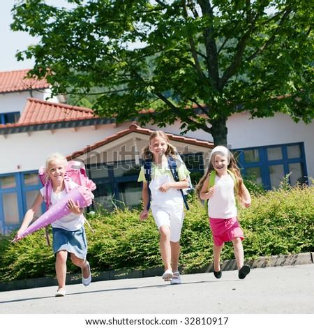 Three kids having fun at school - stock photo