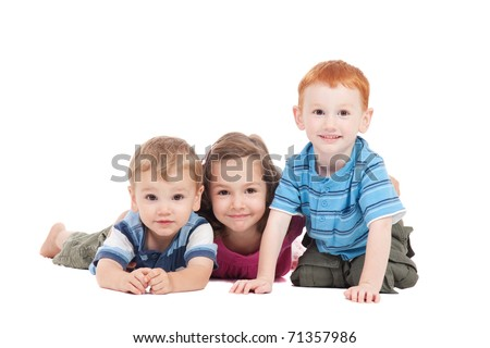Three kids lying on floor. Isolated on white. - stock photo