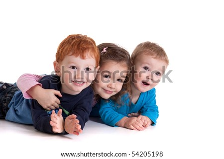 Three kids lying on floor together. Isolated on white - stock photo