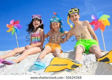 Three kids on beach - stock photo