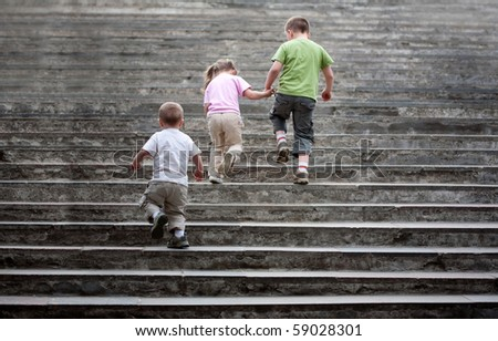 three kids on the stairway
