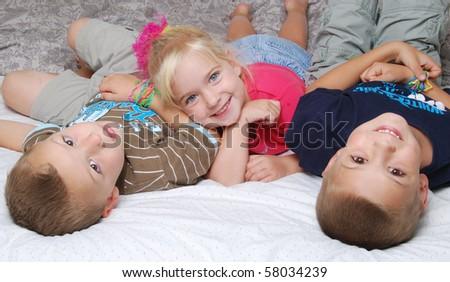 three kids playing - stock photo