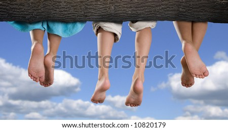 Three kids siting on a branch of a tree - stock photo