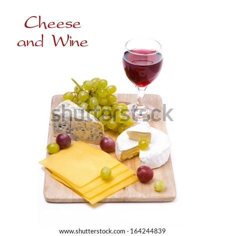 three kinds of cheese, grapes and wine, isolated on white