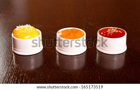 Three kinds of dips on a table - stock photo