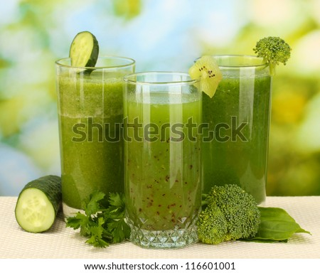Three kinds of green juice on bright background - stock photo