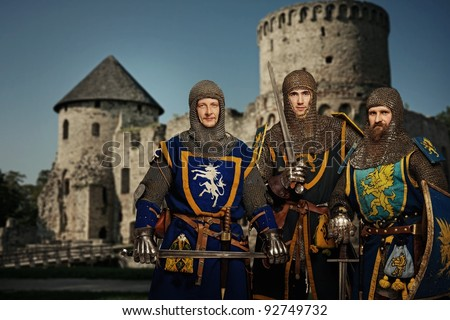 Three knights against medieval castle. - stock photo