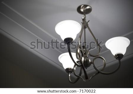 Three lamp metal ceiling light fixture - stock photo
