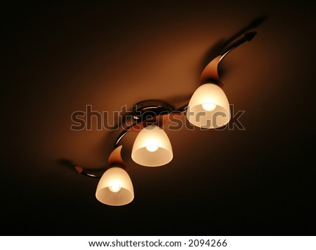 Three lamps on a ceiling - stock photo