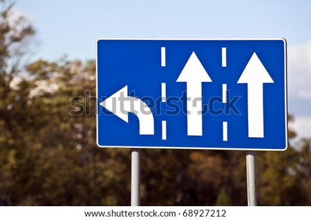 Three-lane traffic sign, left turn and straight arrows. - stock photo