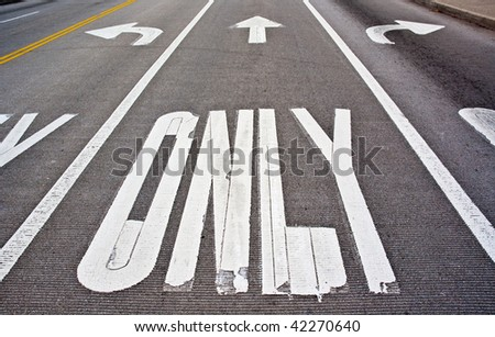 "Three lanes with ""left only"", ""straight only"", ""right only"" markings. Can be used as a concept, when dealing with directions... - stock photo"