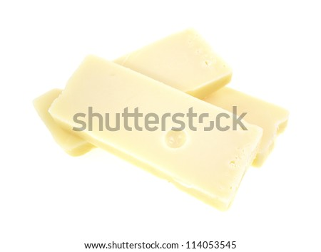 Three large chunks of aged Swiss cheese on a  white background. - stock photo