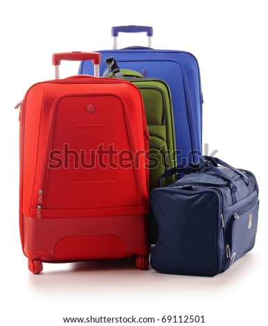 Three large suitcases and travel bag isolated on white - stock photo
