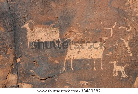 Three large zoomorphic (animal) petroglyphs carved into rock surface by prehistoric Native American(s) at Anasazi Canyon, Southern Utah, USA. - stock photo