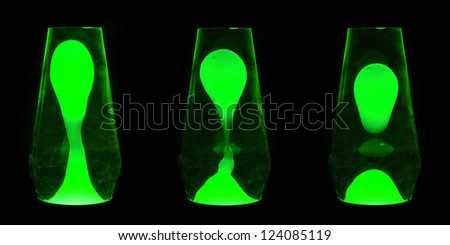 Three lava lamps showing progress of the Green wax going up and separating - stock photo