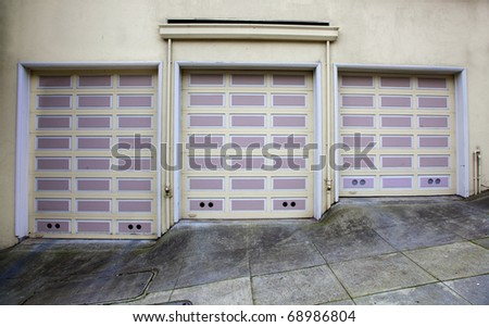 Three lavender and beige garage doors on a hill in San Francisco