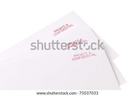 Three letters all of which are marked private and confidential - stock photo
