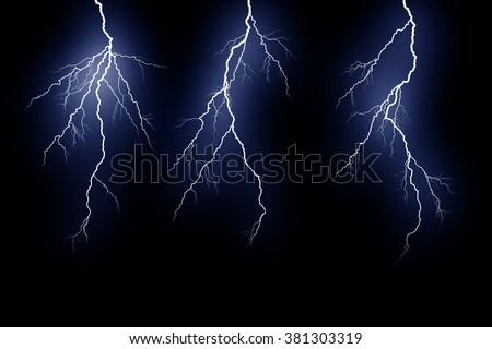 three Lightning extends vertically across a black background - stock photo