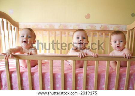 Three Little Baby Girls in Crib