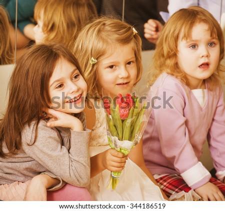 three little cute diverse girls at birthday party having fun - stock photo