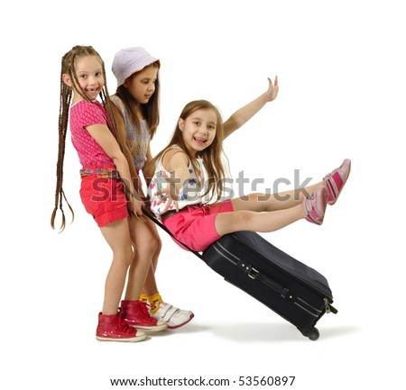 Three little girl with suitcase - stock photo