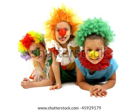 Three little girls as a clowns - stock photo