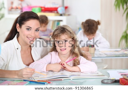 Three little girls in class - stock photo