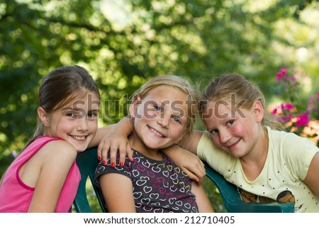 Three little girls together - stock photo