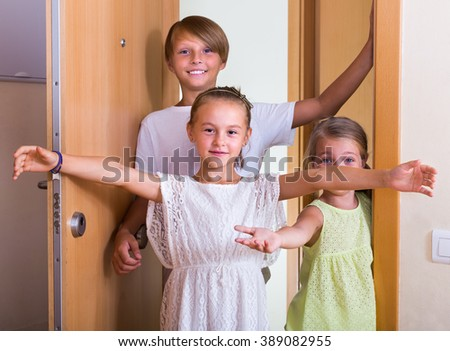 Three little guests coming with friendly visit indoors - stock photo