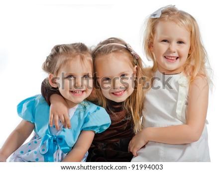 three little pretty smiling girls - stock photo