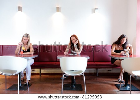 Three lone women sitting in restaurant thinking - stock photo