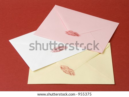 Three love letters on red. - stock photo