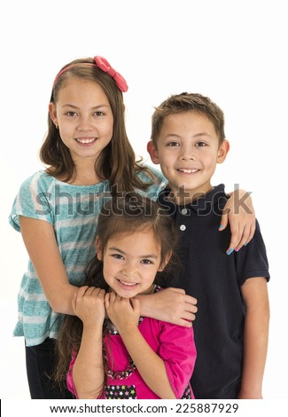 three loving siblings / there are four altogether / no i'm just kidding - stock photo