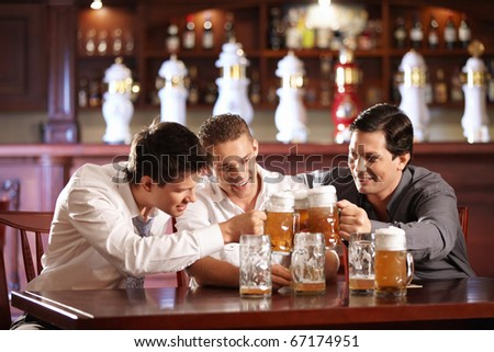 Three lucky people bob mug of beer - stock photo