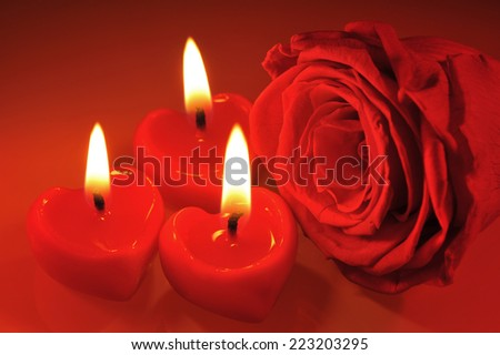 three luminous candlehearts with red rose