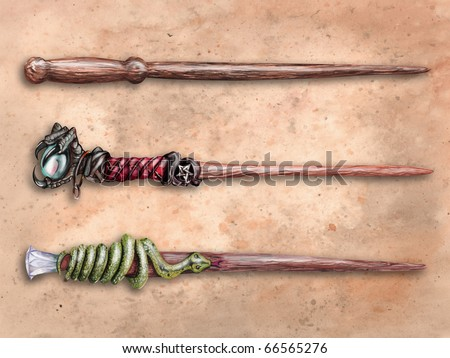 Three magical wizard wands on old parchment - stock photo