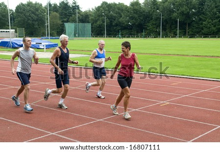 Three man chasing a woman on a race track. - stock photo