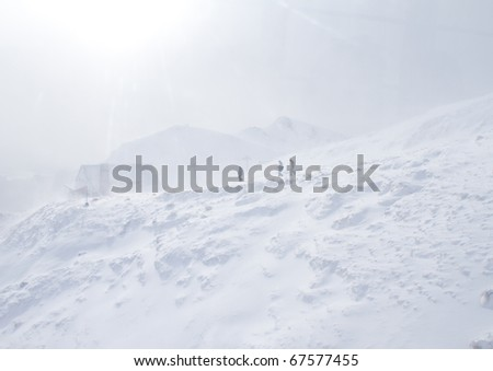 Three man walking in the storm - stock photo