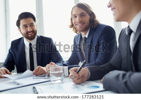 Three managers discussing business plans