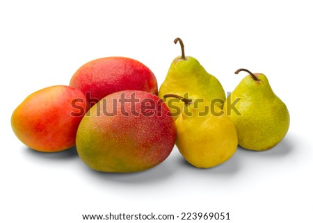 Three mangoes and three pears isolated on a white background