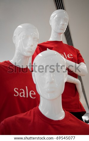 three manikins in red  t-shirts  with sale letters - stock photo